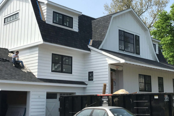 Custom home board and batten siding with PVC trim and moulding